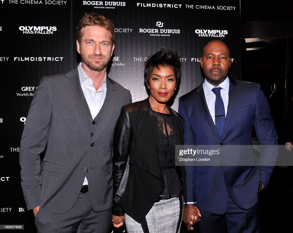 Actor Gerard Butler, actress Angela Bassett, and director Antoine Fuqua attend The Cinema Society with Roger Dubuis and Grey Goose screening of FilmDistrict's 'Olympus Has Fallen' at Tribeca Grand Hotel on March 11, 2013 in New York City.