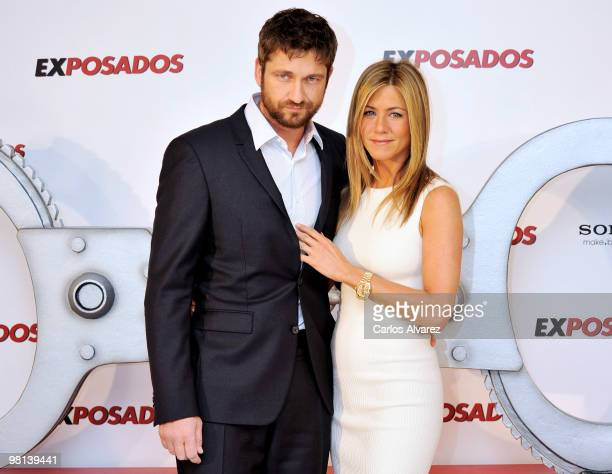 Actor Gerard Butler and actress Jennifer Aniston attend 'Exposados' photocall at the Villamagna Hotel on March 30 2010 in Madrid Spain