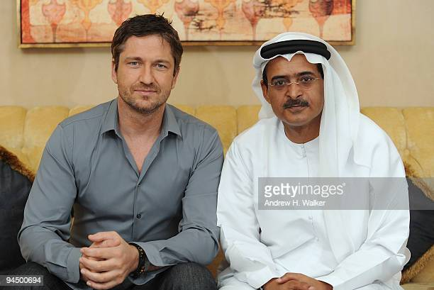 Actor Gerard Butler and DIFF Chairman Abdulhamid Juma during a portrait session on day seven of the 6th Annual Dubai International Film Festival held...