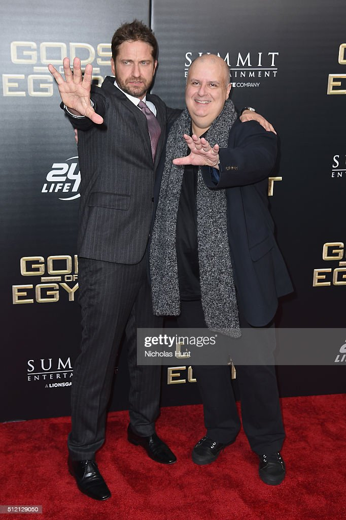 Actor Gerard Butler (L) and director Alex Proyas attend the 'Gods Of Egypt' New York Premiere at AMC Loews Lincoln Square 13 on February 24, 2016 in New York City.