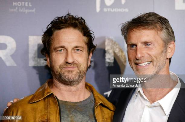 "Actor Gerard Butler and director Andrew Heckler arrive at the premiere of ""Burden"" at the Silver Screen Theater at the Pacific Design Center on..."