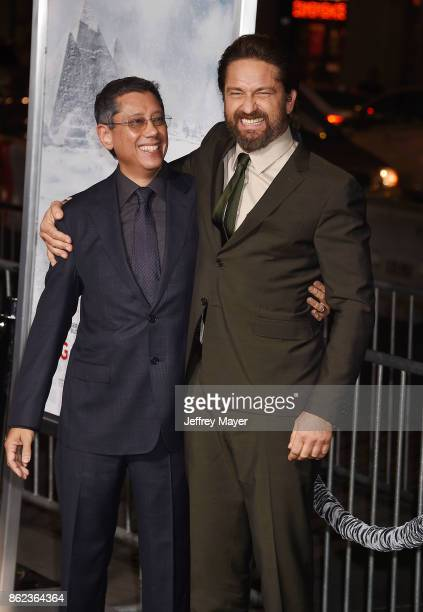 Actor Gerard Butler and Director/Writer/Producer Dean Devlin attend the premiere of Warner Bros Pictures' 'Geostorm' at the TCL Chinese Theatre on...