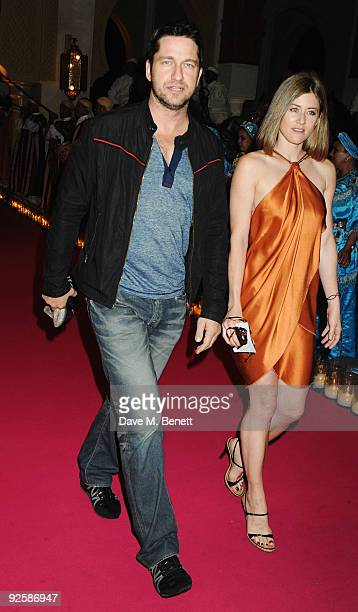 Actor Gerard Butler and guest arrive for the grand opening night of the Kerzner Mazagan Beach Resort on October 31 2009 in El Jadida Morocco 1500...