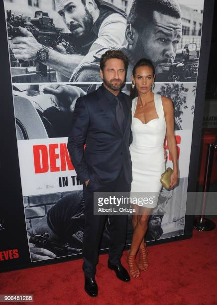 Actor Gerard Butler and Morgan Brown arrive for the Premiere Of STX Films' 'Den Of Thieves' held at Regal LA Live Stadium 14 on January 17 2018 in...