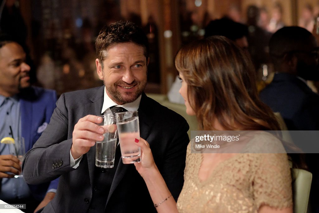 Actor Gerard Butler (L) and Morgan Brown attend the Vanity Fair and Tiffany & Co. private dinner toasting Lupita Nyong'o and celebrating Legendary Style at Shangri-La Hotel on September 11, 2016 in Toronto, Canada.