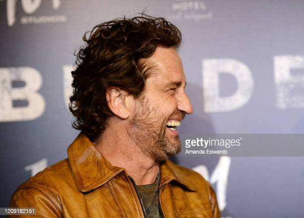 "Actor Gerard Butler arrives at the premiere of ""Burden"" at the Silver Screen Theater at the Pacific Design Center on February 27, 2020 in West..."