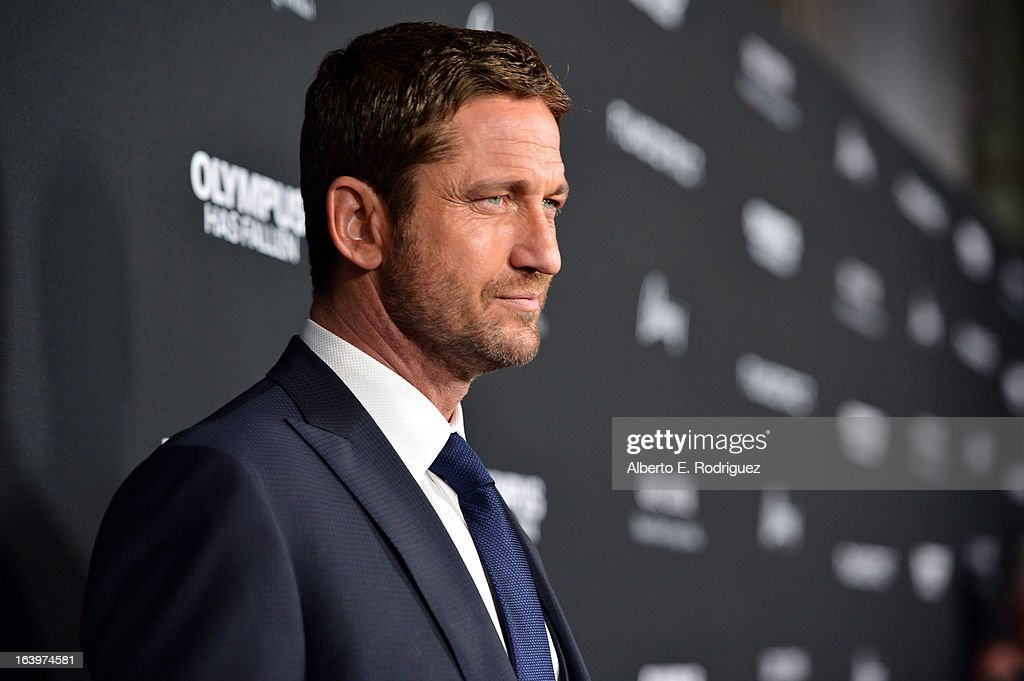 Actor Gerard Butler arrives at the premiere of FilmDistrict's 'Olympus Has Fallen' at ArcLight Cinemas Cinerama Dome on March 18, 2013 in Hollywood, California.