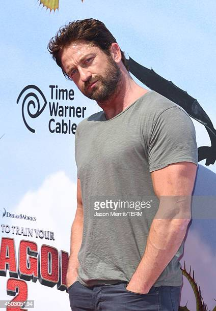 Actor Gerard Butler arrives at the LA premiere of How To Train Your Dragon 2 at the Regency Village Theatre on June 8 2014 in Westwood California