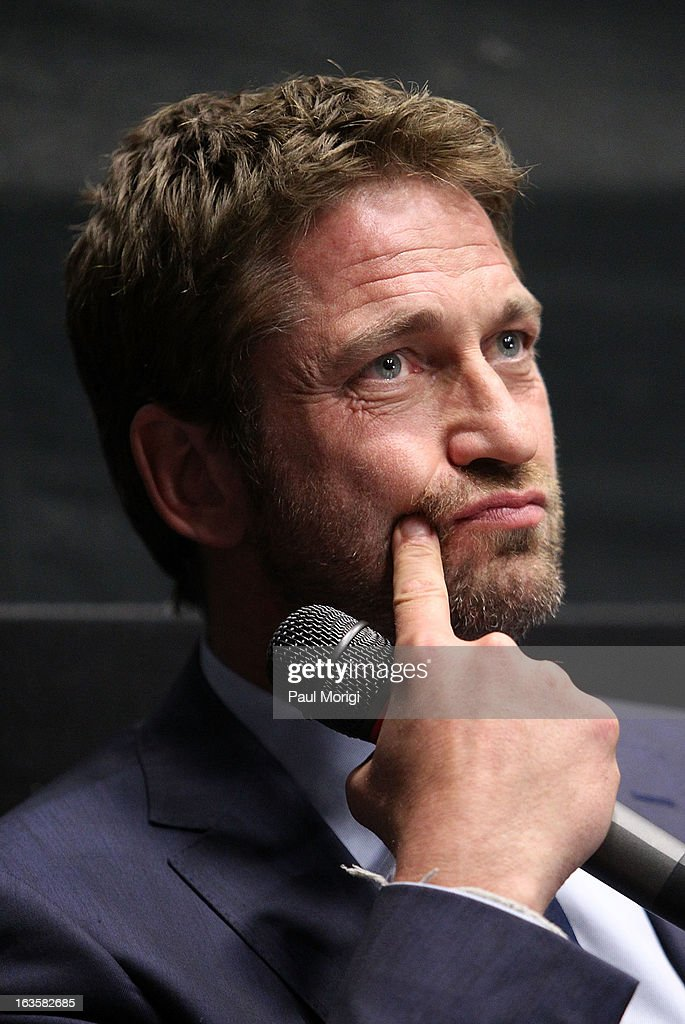 Actor Gerard Butler attends the 'Olympus Has Fallen' screening Q & A session at AMC Loews Georgetown 14 on March 12, 2013 in Washington, DC.