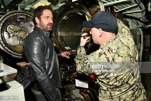Actor Gerard Butler explores the USS Hartford as Hunter Killer cast visit to Naval Submarine Base New London on October 20 2018 in Groton Connecticut