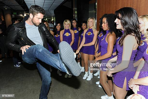 Actor Gerard Butler interacts with the Los Angeles Lakers Girls following a game between the Washington Wizards at Staples Center on March 21 2010 in...