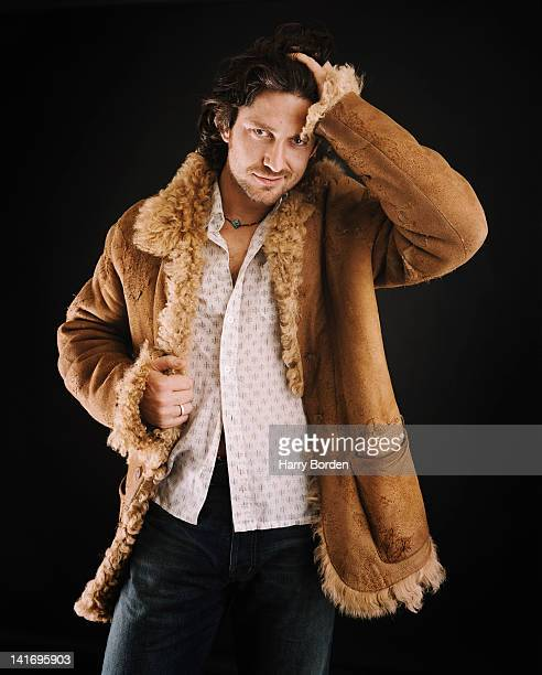 Actor Gerard Butler is photographed for the Sunday Herald on July 2 2002 in London England