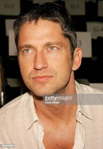 Actor Gerard Butler is seen in the front row at the Naqada Fall 2005 show during MercedesBenz Fashion Week at Smashbox Studios March 20 2005 in...