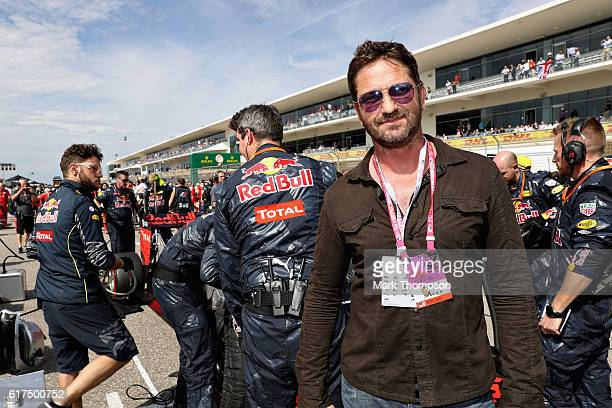 Actor Gerard Butler next to the Red Bull Racing team on the grid before the United States Formula One Grand Prix at Circuit of The Americas on...