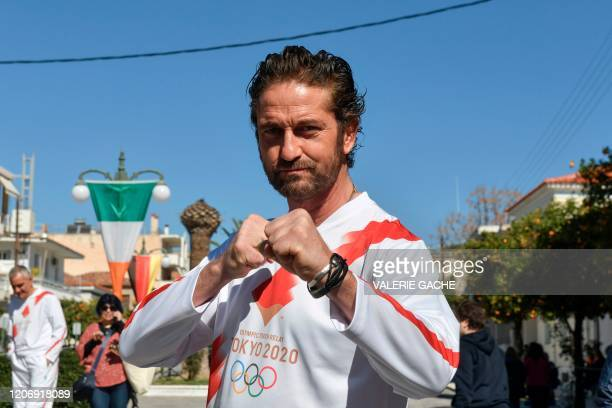 Actor Gerard Butler poses during the Olympic flame relay in Sparta on March 13, 2020 ahead of the Tokyo 2020 Olympic Games.