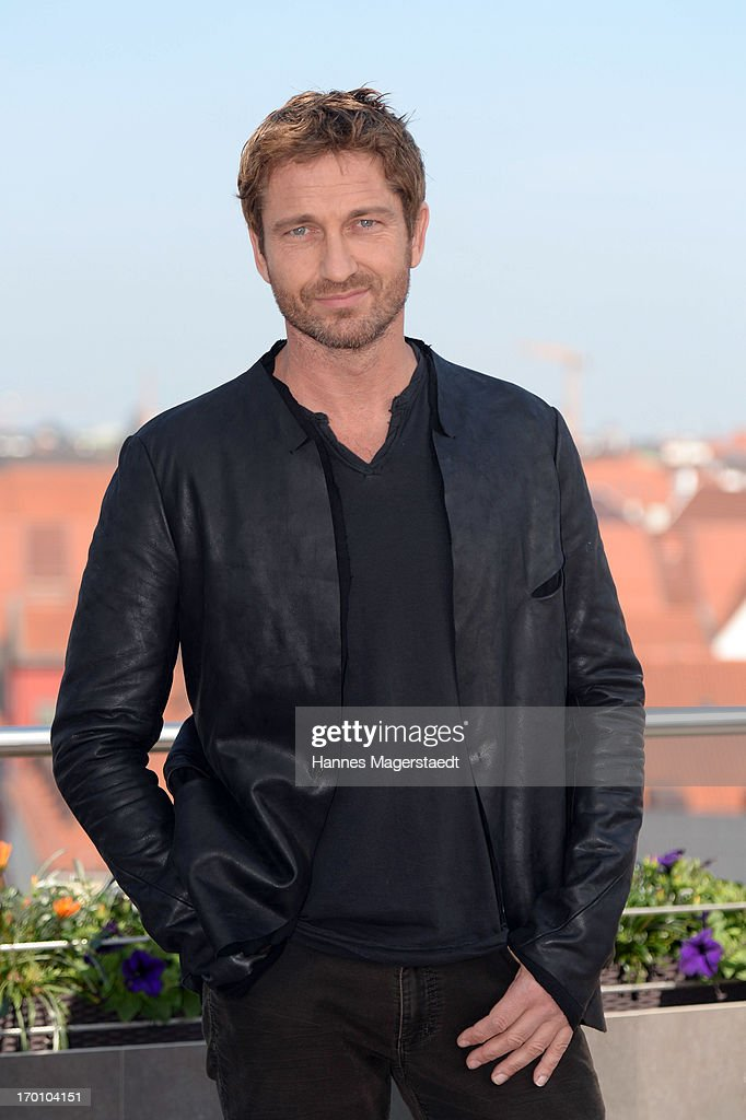 Actor Gerard Butler poses during the 'Olympus Has Fallen - Die Welt in Gefahr' photocall at Hotel Mandarin Oriental on June 7, 2013 in Munich, Germany.