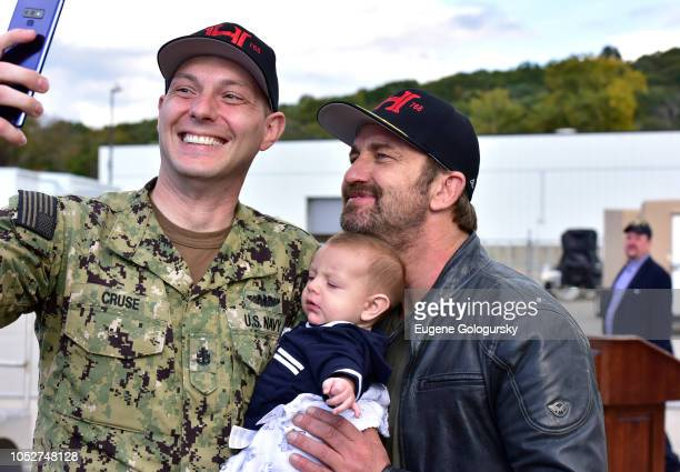 Actor Gerard Butler poses for a photo with sailors and families during Hunter Killer cast visit to Naval Submarine Base New London on October 20 2018...