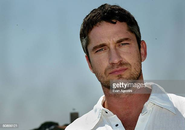 """Actor Gerard Butler poses for photographs at the """"Dear Frankie"""" Press Luncheon at the Synergy Penthouse during the 57th Annual International Cannes..."""