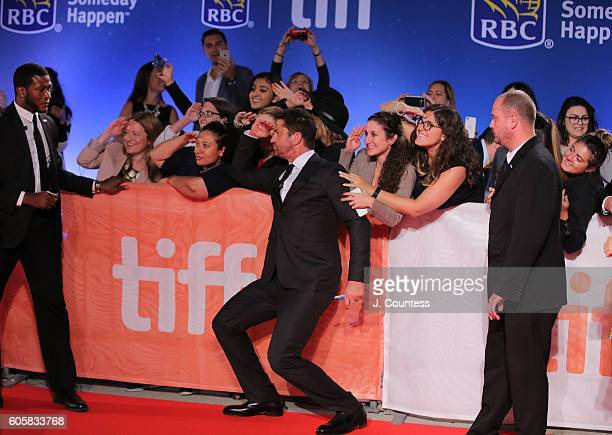 Actor Gerard Butler poses for photos with fans at the 2016 Toronto International Film Festival Premiere of 'The Headhunter's Calling' at Roy Thomson...