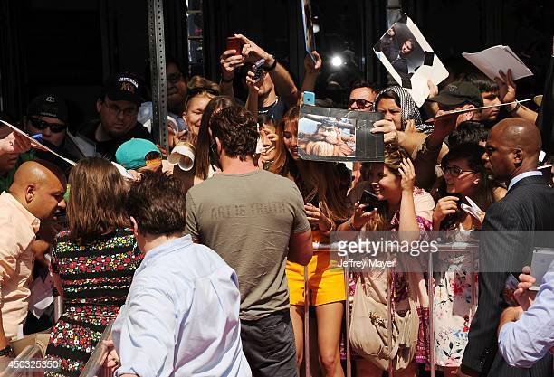 Actor Gerard Butler signs for fans at the Los Angeles premiere of 'How To Train Your Dragon 2' at the Regency Village Theatre on June 8 2014 in...