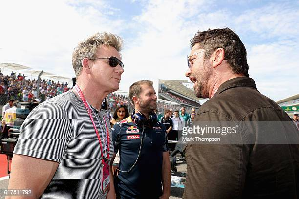 Actor Gerard Butler talks with chef Gordon Ramsey on the grid before the United States Formula One Grand Prix at Circuit of The Americas on October...