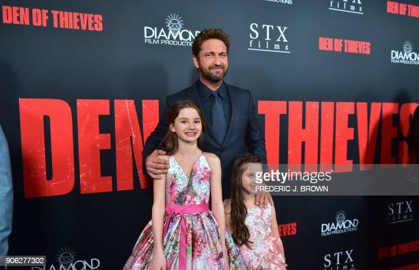 Actor Gerard Butler with Madelyn Lazar and Elle Whitfield arrives for the premiere of the film Den of Thieves in Los Angeles California on January 17...