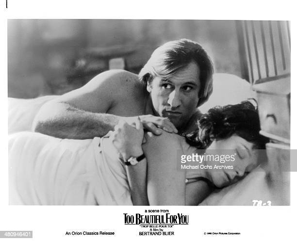 Actor Gerard Depardieu and actress Josiane Balasko in a scene from the Orion Classic movie Too Beautiful for You circa 1989