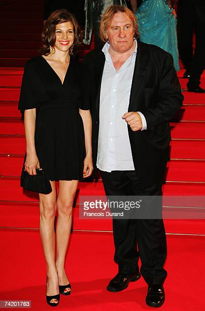 Actor Gerard Depardieu and Clementine Igou depart the premiere for the film Chacun Son Cinema at the Palais des Festivals during the 60th...