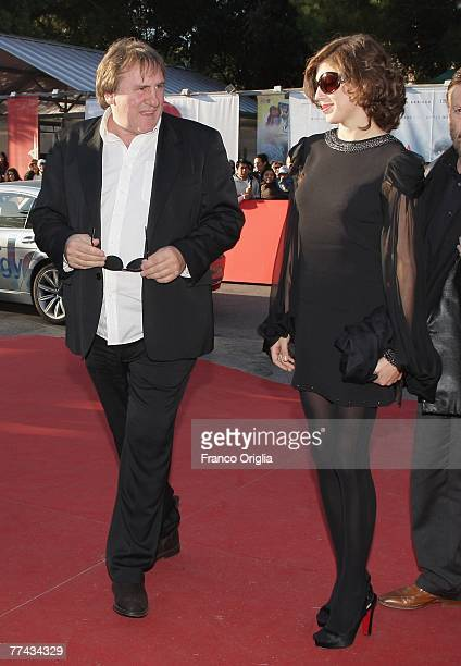 Actor Gerard Depardieu and Clementine Igou walk the red carpet during day 4 of the 2nd Rome Film Festival on October 21 2007 in Rome Italy