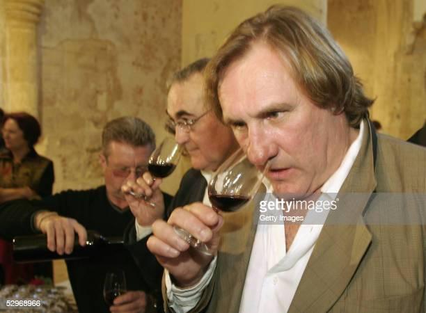 Actor Gerard Depardieu presents his new 2004 vin de garage vintage wine called 'Le bien decide' at his 3 hectare vineyard 'Coteaux du Languedoc' in...