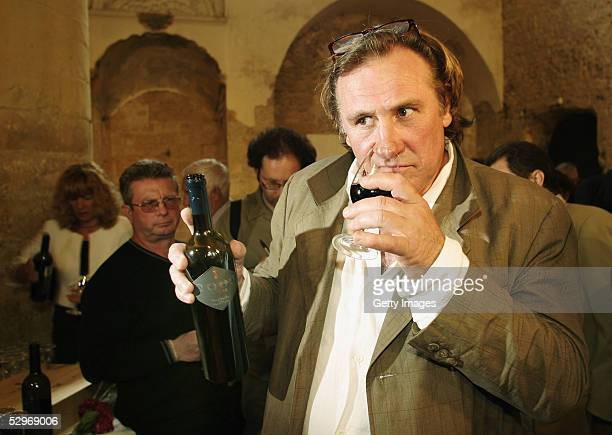 Actor Gerard Depardieu presents his new 2004 vin de garage vintage wine called Le bien decide at his 3 hectare vineyard Coteaux du Languedoc in...