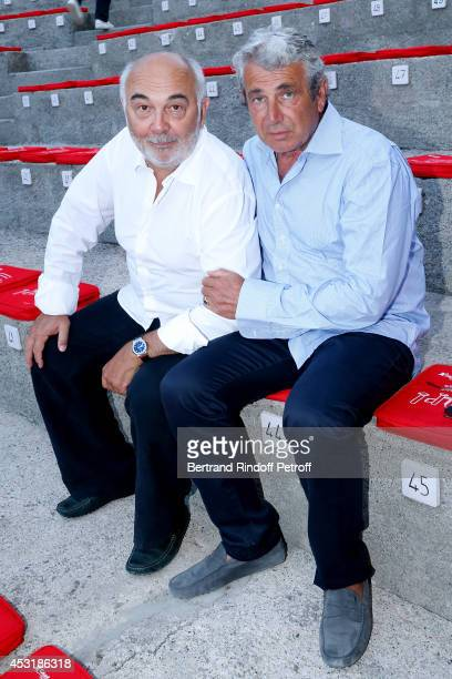 Actor Gerard Jugnot and Artistic Director of the Festival Michel Boujenah attend the 30th Ramatuelle Festival Day 4 on August 4 2014 in Ramatuelle...