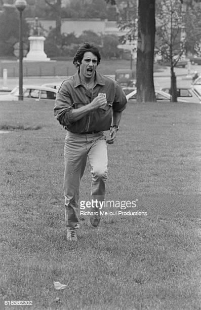 Actor Gerard Lanvin runs through a Paris park