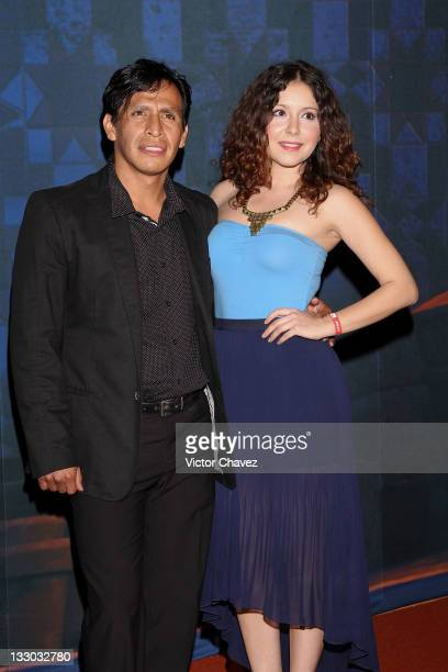 Actor Gerardo Taracena and guest walk the red carpet for the Puss in Boots Mexico City premiere at the Cinemex Antara Polanco on November 15 2011 in...