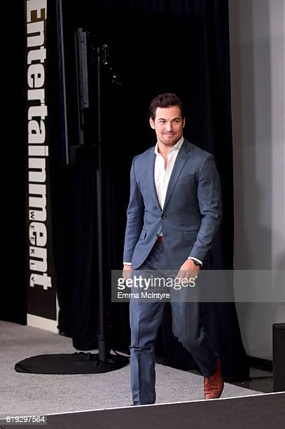Actor Giacomo Gianniotti walks onstage during the Three rounds with the cast of Grey's Anatomy panel at Entertainment Weekly's PopFest at The Reef on...