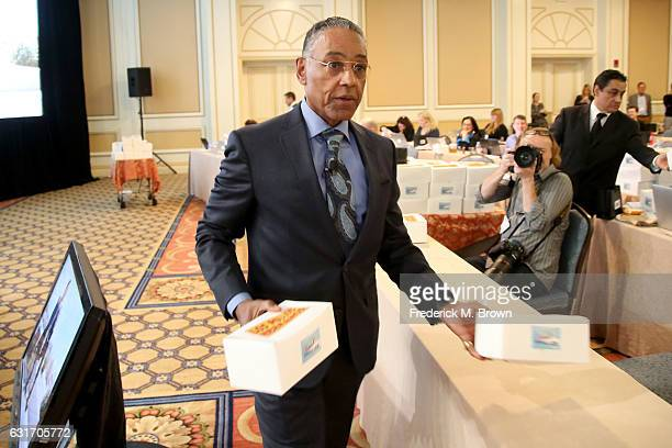 Actor Giancarlo Esposito passes out boxes of Los Pollos Hermanos chicken during the 'Better Call Saul' panel of the AMC portion of the 2017 Winter...