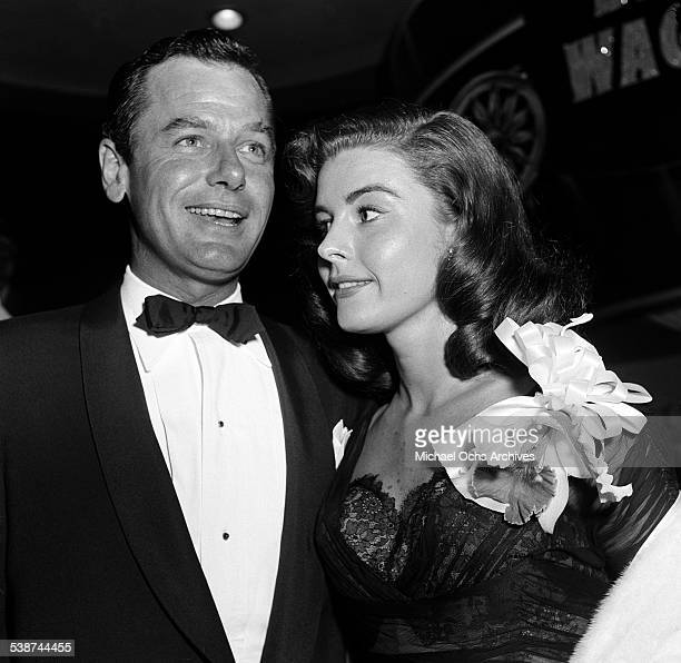 Actor Gig Young and Elaine Stewart attend the premire of The Egyptian in Los AngelesCA