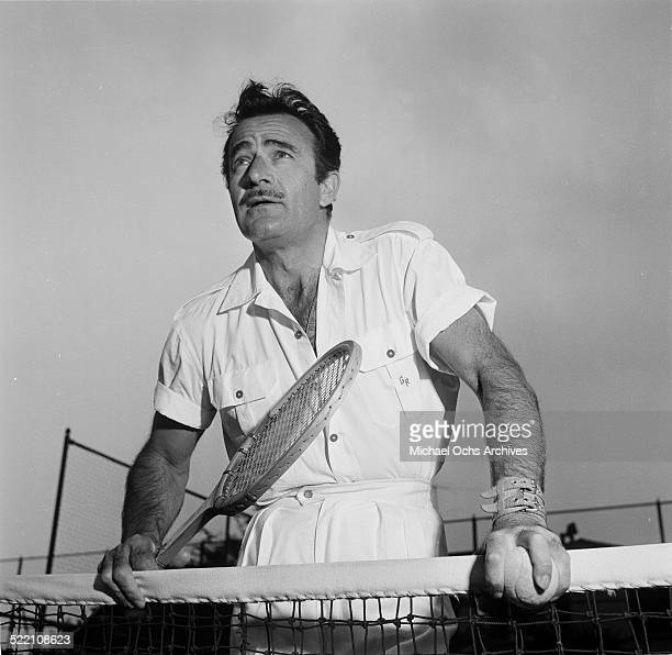 Actor Gilbert Roland plays tennis during a portrait session at home in Los AngelesCA