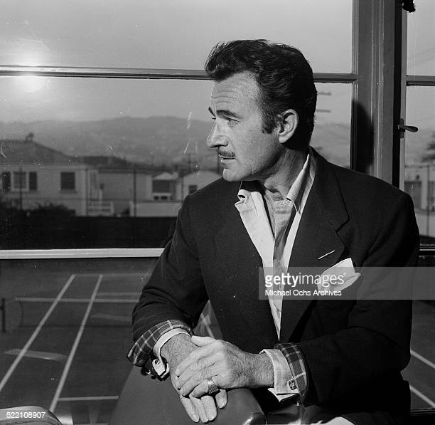 Actor Gilbert Roland poses during a portrait session at home in Los AngelesCA