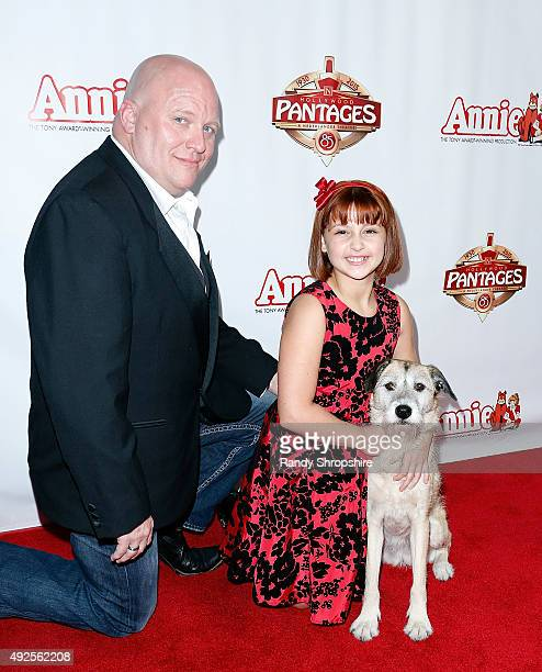 Actor Gilgamesh Taggett actress Issie Swickle and Macy the dog playing Sandy attend the premiere of Annie at the Hollywood Pantages Theatre on...