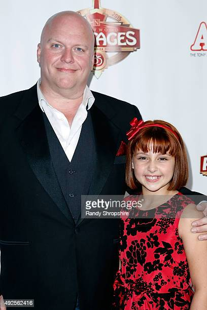 Actor Gilgamesh Taggett and actress Issie Swickle attend the premiere of Annie at the Hollywood Pantages Theatre on October 13 2015 in Hollywood...