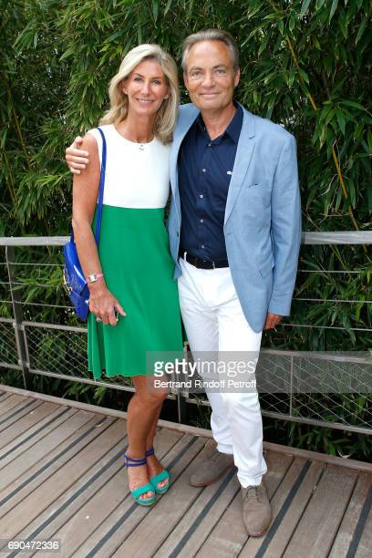 Actor Gilles Cohen and his wife Karine attend the 2017 French Tennis Open Day Four at Roland Garros on May 31 2017 in Paris France