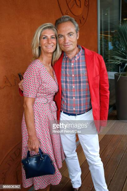 Actor Gilles Cohen and his wife Karine Paschal attend the 2018 French Open Day Eight at Roland Garros on June 3 2018 in Paris France