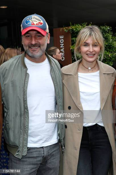 Actor Gilles Lellouche and Alizee Guinochet attend the 2019 French Tennis Open Day Fifteen at Roland Garros on June 09 2019 in Paris France