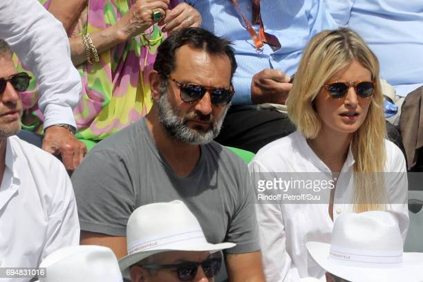 Actor Gilles Lellouche is pictured inside Court Philippe Chatrier prior to the mens singles final match between Rafael Nadal of Spain and Stan...