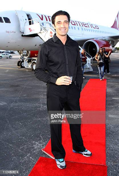 Actor Gilles Marini poses after Virgin America's inaugural flight from Los Angeles to Fort Lauderdale Lauderdale International Airport on November 18...