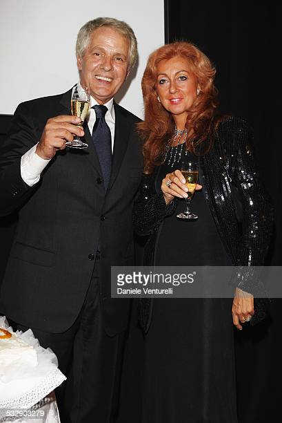 "Actor Giuliano Gemma and his wife attend the Kineo ""Diamanti al Cinema Italiano"" Award Ceremony Photocall at the Hotel del Bains during the 65th..."