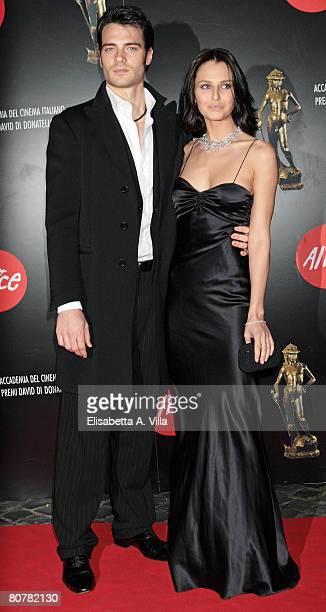 Actor Giulio Berruti and actress Anna Safroncik arrive at the Italian Movie Awards ''David Di Donatello'' at the Auditorium Conciliazione on April 18...