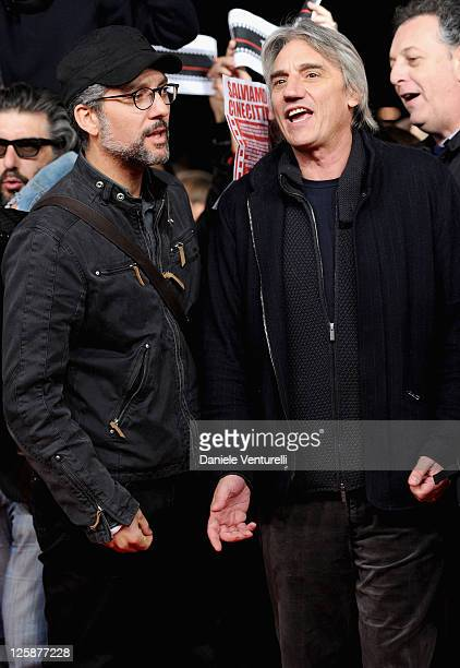Actor Giuseppe Fiorello and director Mimmo Calopresti join protesters on the red carpet during the opening of The 5th International Rome Film...
