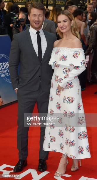 US actor Glen Powell and English actor Lily James pose on the red carpet upon arrival to attend the World premiere of the film 'The Guernsey Literary...